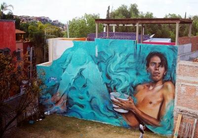 -Chac Mool-Street art in San Miguel de Allende, Mexico, by artist Young Jarus en.wikipedia.org-wiki-Chacmool