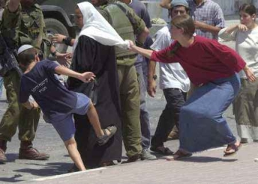 israel-settlers-attack-palestine-woman