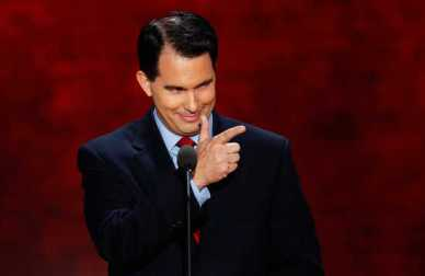 Wisconisn Governor Scott Walker gestures as he addresses the second session of the Republican National Convention in Tampa