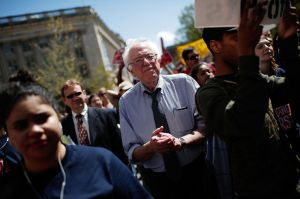 "WASHINGTON, DC - APRIL 20:  U.S. Sen. Bernie Sanders (I-VT) participates in a ""Don't Trade Our Future"" march organized by the group Campaign for America's Future April 20, 2015 in Washington, DC. The event was part of the Populism 2015 Conference which is conducting their conference with the theme ""Building a Movement for People and the Planet.""   (Photo by Win McNamee/Getty Images)"