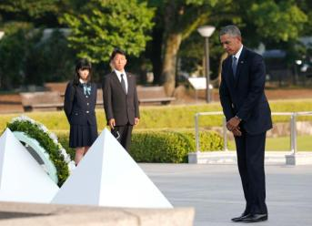 U.S. President Barack Obama stands after laying a wreath at the Hiroshima Peace Memorial Park in Hiroshima, western, Japan, Friday, May 27, 2016. Obama on Friday became the first sitting U.S. president to visit the site of the world's first atomic bomb attack, bringing global attention both to survivors and to his unfulfilled vision of a world without nuclear weapons. (AP Photo/Shuji Kajiyama)